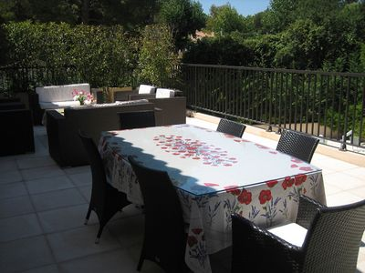 Private veranda showing dining and sitting areas
