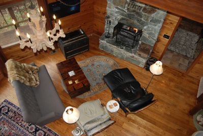 Relax in front of the fire in this comfortable seating living space.