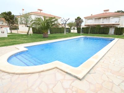 Photo for Apartment for four people with large area of gardens and swimming pool