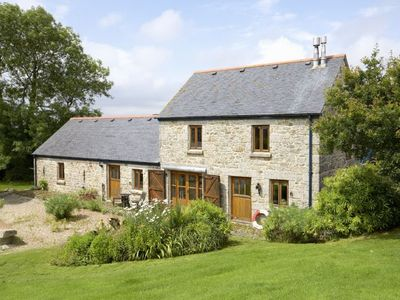 Photo for Tregadjack Barn is an enchanting, 'upside-down', detached, local Cornish stone holiday cottage.
