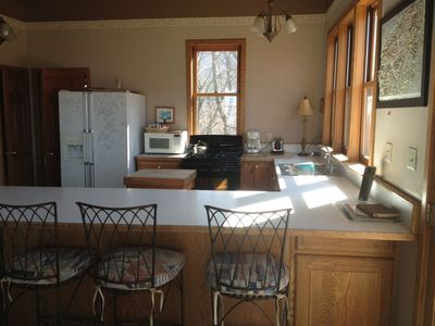 Large, fully equipped kitchen with incredible views
