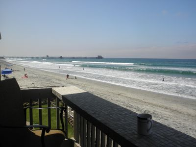 Enjoy morning coffee and beautiful sunsets from furnished  oceanfront balcony.