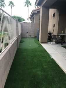 Putting green in front of  back patio