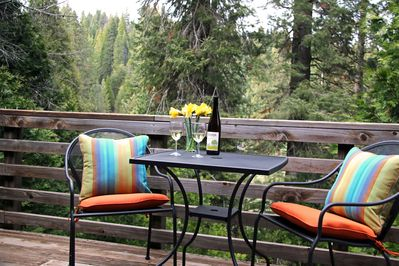 Relaxing seating on the deck overlooking an amazing meadow view.