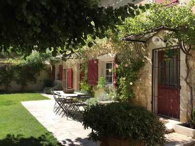 Photo for Mas ROBIANNE charming stone farmhouse with swimming pool in the heart of a typical village