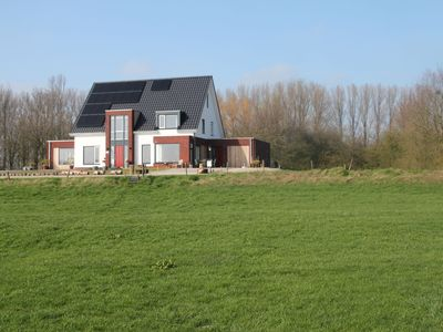 Photo for New, very romantic holiday home in a unique location directly by the Rhine