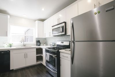 Gourmet kitchen with stainless steel appliances and dishwasher.