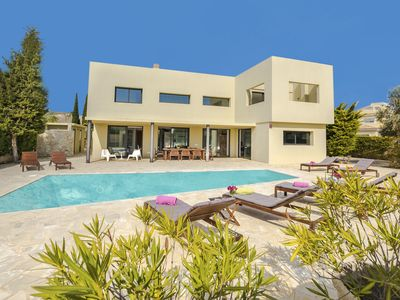 Photo for This 4-bedroom villa for up to 8 guests is located in Ibiza and has a private swimming pool, air-con