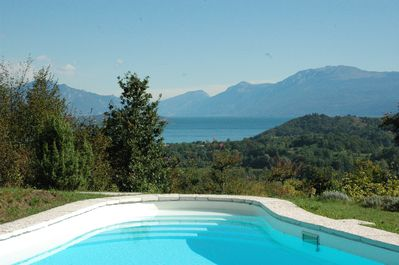Lake Garda and mountain views from the pool of Monte Pico