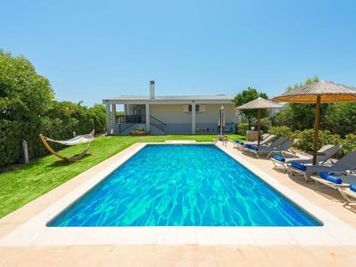 Photo for This 4-bedroom villa for up to 8 guests is located in Gennadi and has a private swimming pool, air-c