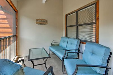Savor morning coffee and evening nightcaps on the screened porch.