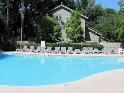 Photo for Enjoy living next to Hot tub and Pool, walking to Beach and Golf, or Biking all