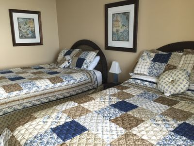 Two queen beds gives room for 4. Bedroom also has a flat screen T.V.