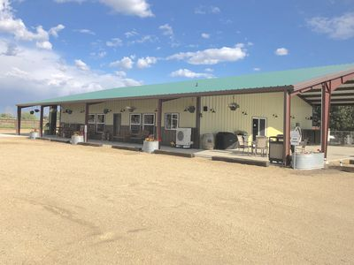Photo for Rustic Ranch Lodge sleeps 22 with spacious living area and horse stable