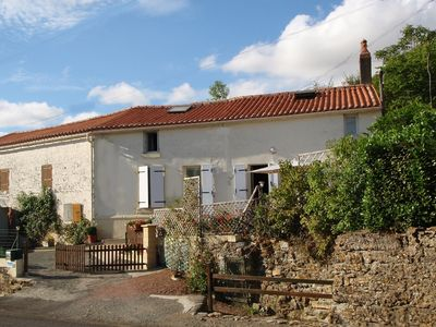Photo for Self-catering renovated house, built in limestone!