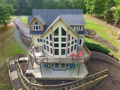 Photo for Hidden Cottage - Contemporary Lakefront Nestled in Private Cove, Great For Swimming & Fishing