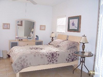 Master bedroom with queen bed and view of mountains.  TV is in bedroom.