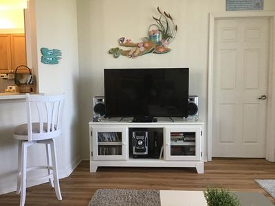 "Entertainment center w/50"" HDTV, DVD player & stero. Many DVD's & CD's available"