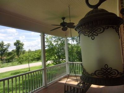 Enjoy views from the big country front porch and swing.