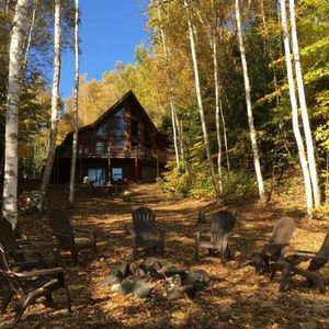 Log Home Luxury awaits on the west shore of AuTrain Lake! Paddleboat and dock!
