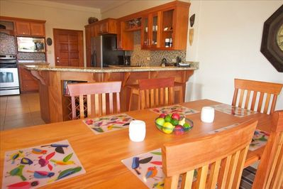 Kitchen and dining area which leads out to a very large deck with outdoor dining