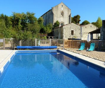 Photo for Farmhouse with heated pool & games barn.  in village with shop, bar and chateau.