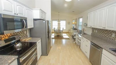 Photo for 1 block from the beach / Private Hot Tub/ Walk to desired restaurants.