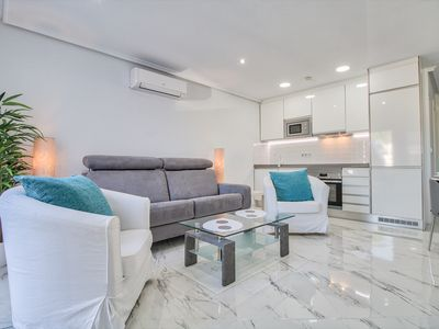 Photo for Immaculate modern apartment in the high st of the very popular Ciudad Quesada.