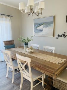Photo for Coastal chic waterfront townhouse w/bayside sunsets.
