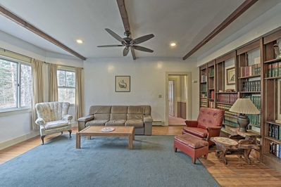 This lower-level unit features a library and plenty of furniture to lounge on.