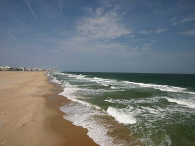 Photo for 3 BR, 2 BA, 2 Balconies,Steps to the Beach - Summer Specials