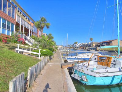 Photo for Waterfront getaway for couples/small families! Pools & fitness room! 1 dog ok