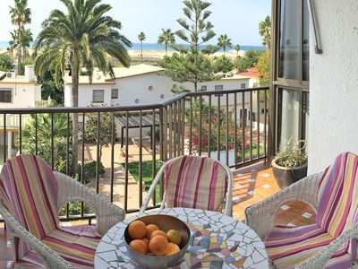 Photo for Holiday home with balcony and ocean view, 2 min. to the beach, sleeps 4.