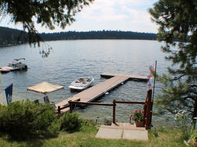 Photo for Cute, rustic lakefront cottage with dock