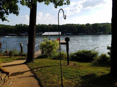 Photo for Quiet  location, beautiful lakefront home in a cove. Private covered boat dock!