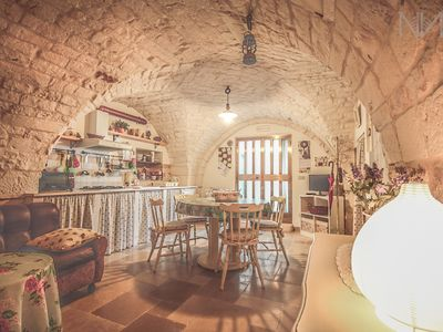 Photo for Typical tavern built in stone - Cisternino city center