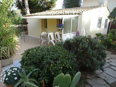 Photo for Quiet little cottage on the seafront in a Mediterranean garden
