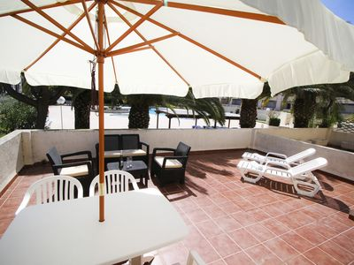 Photo for PUNTA PRIMA 4 with communal pool, beach at 100m