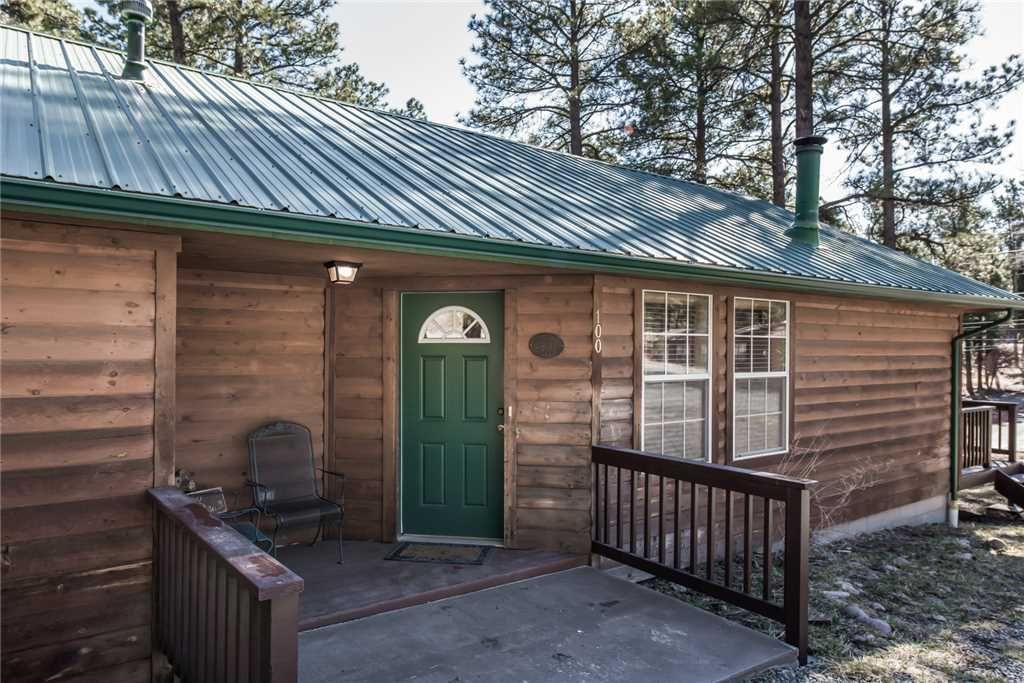 Cowboy cabin 2 bedrooms sleeps 6 hot tub grill wood for 6 bedroom cabins in ruidoso nm