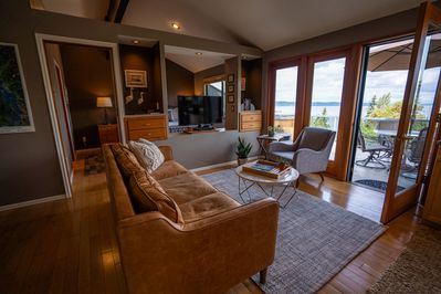 Expansive Living Room opens onto your own private deck with hot tub.