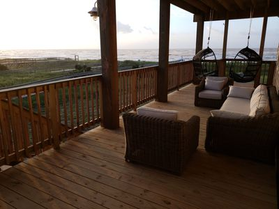 Great ocean views! Large patio set and hanging chairs seat 8 comfortably.