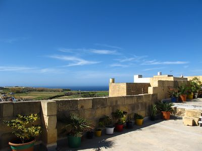 Distant sea views from the roof terrace:  Dwejra Bay