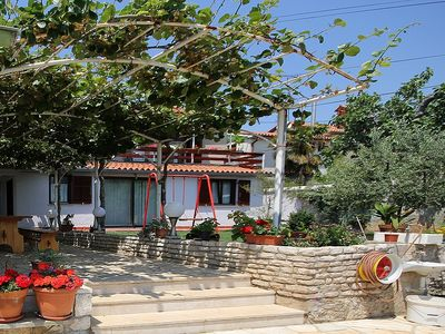 Photo for Apartment with 2 bedrooms, bathroom, washing machine, terrace, garden and barbecue - only 200 meters to the beach