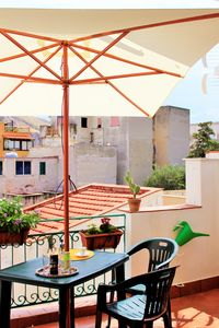 This is a terrace next to the kitchen where you can eat!