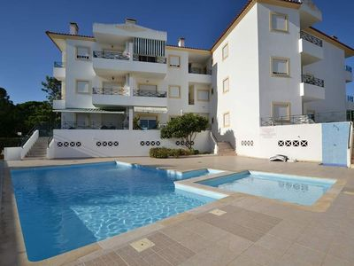 Photo for Sunny 1 bedroom apartment 2-5 pers. with shared pool, WIFI Internet, only 800m to the beach