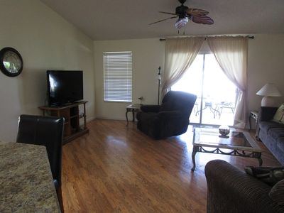 "Comfortable living room with 50"" TV with cable"