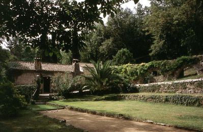 The mill with its ancient aqueduct. The lovely gardens include Roman ruins.