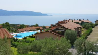 Photo for Two-room apartment with fantastic views of Gaino on Lake Garda