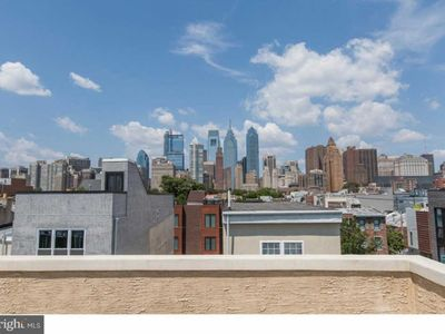 Roomy, 4 BD/2.5Bth w/Rooftop Deck.  Parking Passes! Great Location!