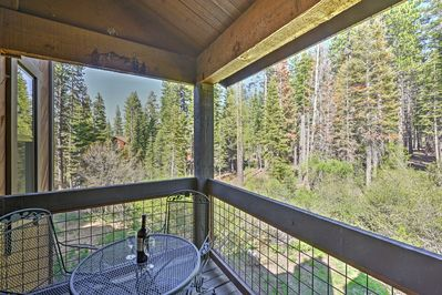 Admire the wooded view from your private balcony.